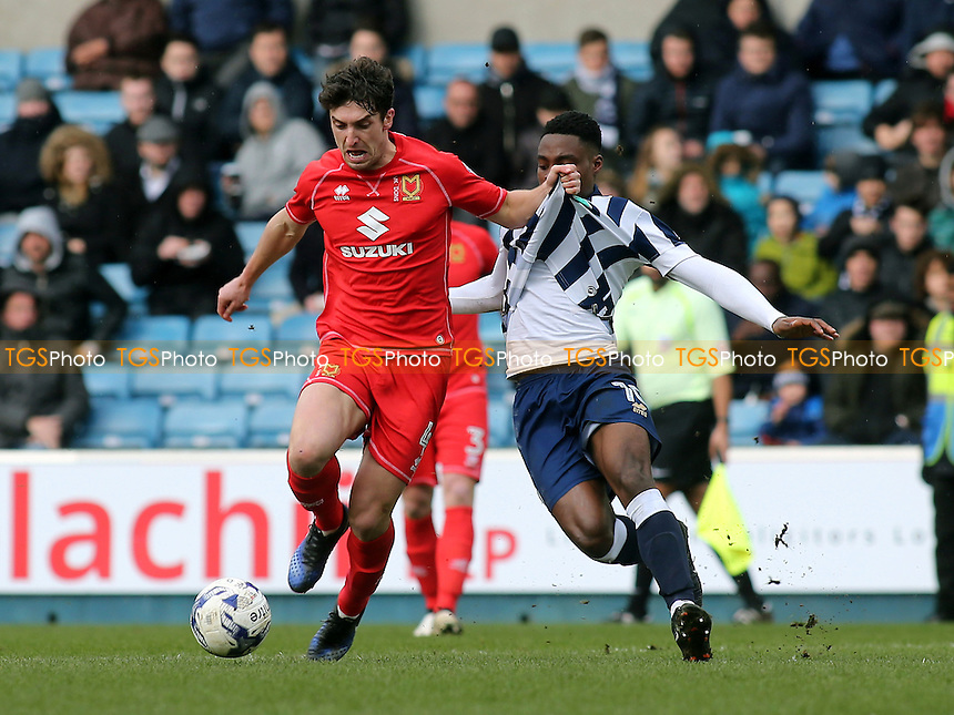 Joe Walsh of MK Dons tries to shake off a challenge from Millwall's Fred Onyedinma during Millwall vs MK Dons, Sky Bet EFL League 1 Football at The Den on 4th March 2017