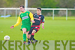 Kerry's Shane Doolin gets there before Cork's Shane Duggan in the EA Sports Cup at Mounthawk Park on Tuesday.