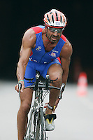 02 SEP 2007 - HAMBURG, GER - Sir Rocco Forte (GBR) unclips his shoes as he prepares to enter transition after the bike - World Age Group Triathlon Championships. (PHOTO (C) NIGEL FARROW)