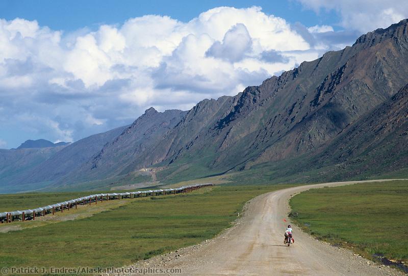 Bicycle rider, Atigun Canyon, Brooks range, Dalton Highway, Trans Alaska Pipeline, Alaska