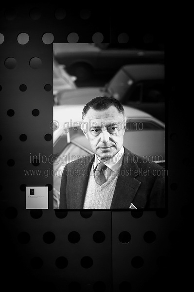 Giovanni Agnelli's portrait is seen at his cars exhibition at the Car Museum of Turin, Italy, March 12, 2013.