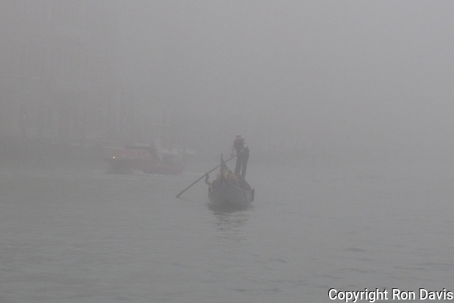 Gondola on the Grand Canal in dense fog, Venice, Italy