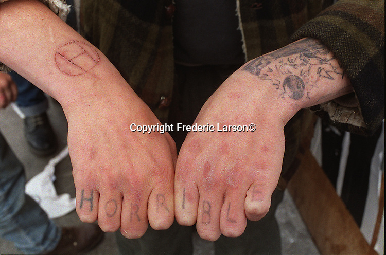 """Farmboy"" friends of Travis and Dante has their bands name tattooed on his fingers."