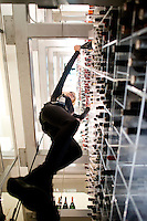 """One of Aurole´s """"angels"""" retrieves a bottle of wine from the restaurtant´s verticle wine cellar at Mandalay Bay, Las Vegas, Nevada, USA"""