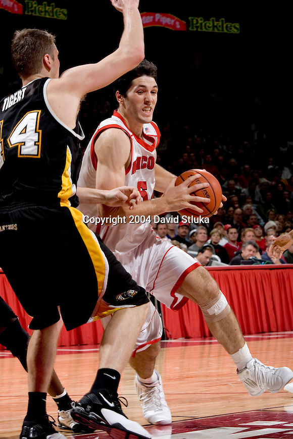 MADISON, WI - DECEMBER 15: Forward Zach Mike Wilkinson #54 of the Wisconsin Badgers during the game against UW-Milwaukee at the Kohl Center on December 15, 2004 in Madison, Wisconsin. The Badgers defeated UW-Milwaukee 66-37. Photo by David Stluka