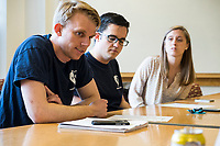 """Sam Carson (left), 28, a Master in Public Policy graduate student at Harvard, leads the Resistance School logistics group volunteer meeting before a session of Resistance School in the Taubman Building of Harvard University's John F. Kennedy School of Government, on Thurs., April 27, 2017. The goal of the meeting was to plan how to direct attendees from the registration location to the lecture location. Resistance School was started by progressive graduate students at Harvard after the Nov. 8, 2016, election of President Donald Trump. Resistance School describes itself as a """"practical training program that will sharpen the tools [needed] to fight back at the federal, state, and local levels."""" Resistance School puts on live lectures by leading progressives that are streamed and archived online alongside other information on the Resistance School website. During the lectures, teams of volunteers engage with followers on social media, including Facebook and twitter, sharing soundbytes, quotations, and supplementary materials as the lectures happen."""