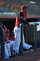 Hickory Crawdads pitching coach Jose Jaimes (20) watches the action from the dugout during the game against the Greensboro Grasshoppers at L.P. Frans Stadium on May 26, 2019 in Hickory, North Carolina. The Crawdads defeated the Grasshoppers 10-8. (Brian Westerholt/Four Seam Images)