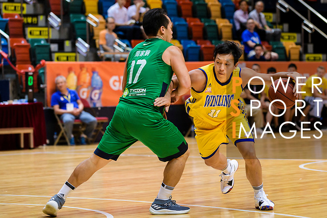 Poon Chi Ho #11 of Winling Basketball Club handles the ball against the Tycoon during the Hong Kong Basketball League playoff game between Winling and Tycoon at Queen Elizabeth Stadium on July 24, 2018 in Hong Kong. Photo by Marcio Rodrigo Machado / Power Sport Images