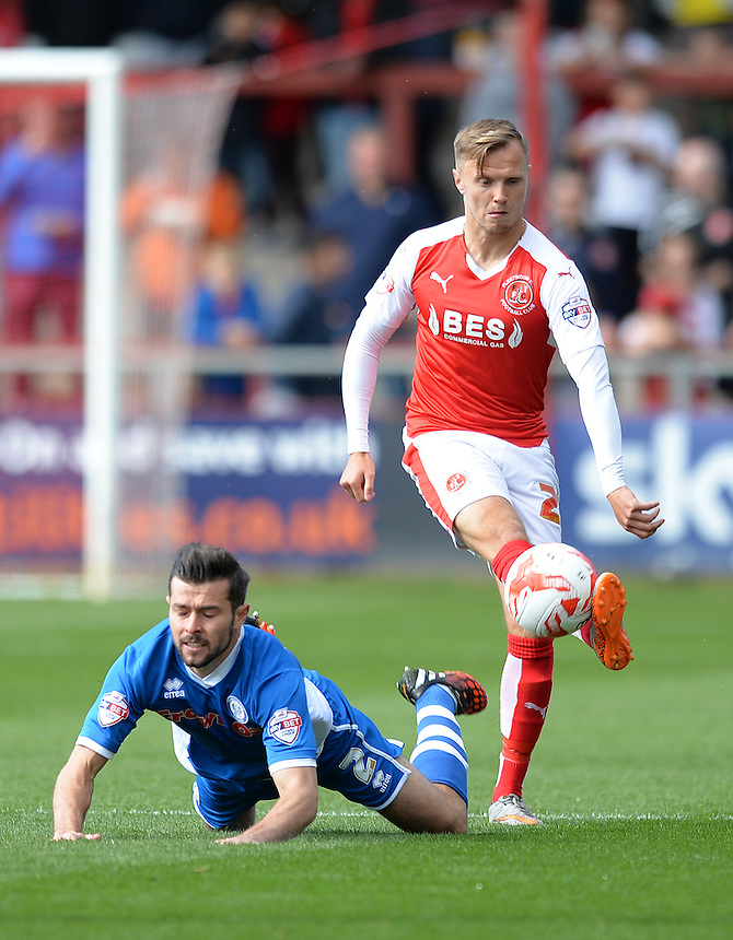 Fleetwood Town's David Ball fouls Rochdale's Peter Vincenti<br /> <br /> Photographer Dave Howarth/CameraSport<br /> <br /> Football - The Football League Sky Bet League One - Fleetwood Town v Rochdale -  Saturday 5th September 2015 - Highbury Stadium - Fleetwood<br /> <br /> &copy; CameraSport - 43 Linden Ave. Countesthorpe. Leicester. England. LE8 5PG - Tel: +44 (0) 116 277 4147 - admin@camerasport.com - www.camerasport.com