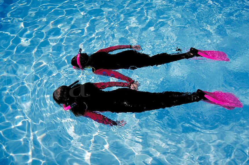 Children in diving gear snorkeling in pool. Children. Douglaston NY.