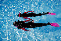 Children in diving gear snorkeling in pool. Children. Douglaston NY.