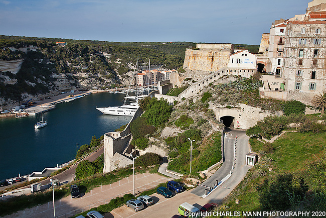 The harbor at Bonifacio in Southern Corsica is accessed by a narrow natural inlet.