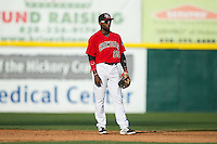 Hickory Crawdads second baseman Travis Demeritte (25) on defense against the Greensboro Grasshoppers at L.P. Frans Stadium on May 6, 2015 in Hickory, North Carolina.  The Crawdads defeated the Grasshoppers 1-0.  (Brian Westerholt/Four Seam Images)