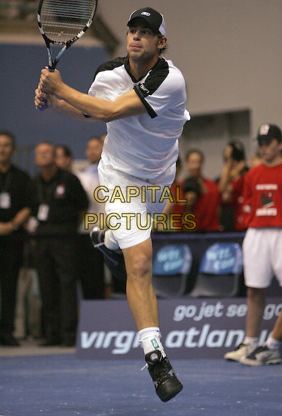 ANDY RODDICK.Plays at the 12th Annual World Team Tennis Smash Hits benefiting The Elton John AIDS Foundation held at The Bren Events Center at UC Irvine in Irvine, California, .October 11th 2004..full length sport racket racquet.Ref: DVS.www.capitalpictures.com.sales@capitalpictures.com.©Debbie VanStory/Capital Pictures .