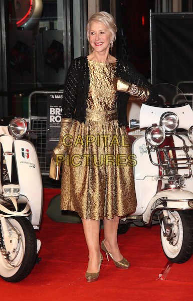 DAME HELEN MIRREN .European Premiere of 'Brighton Rock' at the Odeon West End, Leicester Square, London, London, England, UK,.1st February 2011..full length gold dress black jacket cardigan gloves platform shoes clutch bag motorcycle motorbike bike scooter moped.CAP/ROS.©Steve Ross/Capital Pictures
