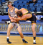 BROOKINGS, SD - NOVEMBER 9:  Alex Kocer from South Dakota State controls the leg of Shane Fenngham from Drexel in their 149 pound match Saturday at Frost Arena. (Photo by Dave Eggen/Inertia)