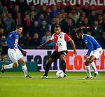 Nederland, Rotterdam, 30 oktober 2013<br /> KNVB Beker<br /> Seizoen 2013-2014<br /> Feyenoord-HSV Hoek<br /> Samuel Armenteros (m.) van Feyenoord wordt omringt door Fabian Wilson (l.) en Lionel Fitsch (r.) van HSV Hoek
