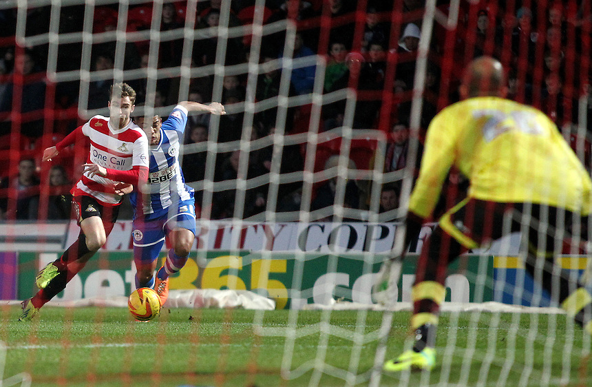 Doncaster Rovers' James Coppinger is fouled by Wigan Athletic's Tylas Browning, earning his side a penalty<br /> <br /> Photo by Rich Linley/CameraSport<br /> <br /> Football - The Football League Sky Bet Championship - Doncaster Rovers v Wigan Athletic - Saturday 18th January 2014 - Keepmoat Stadium - Doncaster<br /> <br /> &copy; CameraSport - 43 Linden Ave. Countesthorpe. Leicester. England. LE8 5PG - Tel: +44 (0) 116 277 4147 - admin@camerasport.com - www.camerasport.com
