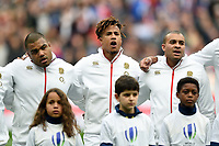 Kyle Sinckler, Anthony Watson and Jonathan Joseph of England sing the national anthem. Natwest 6 Nations match between France and England on March 10, 2018 at the Stade de France in Paris, France. Photo by: Patrick Khachfe / Onside Images