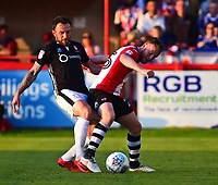 Lincoln City's Neal Eardley vies for possession with Exeter City's Jake Taylor<br /> <br /> Photographer Andrew Vaughan/CameraSport<br /> <br /> The EFL Sky Bet League Two Play Off Second Leg - Exeter City v Lincoln City - Thursday 17th May 2018 - St James Park - Exeter<br /> <br /> World Copyright &copy; 2018 CameraSport. All rights reserved. 43 Linden Ave. Countesthorpe. Leicester. England. LE8 5PG - Tel: +44 (0) 116 277 4147 - admin@camerasport.com - www.camerasport.com
