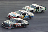 Dale Earnhardt battles Alan Kulwicki and Rusty Wallace enroute to victory at Atlanta in November 1989. (Photo by Brian Cleary)