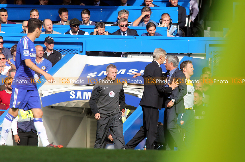 Arsenal Manager, Arsene Wengar, pushes Chelsea Manager, Jose Mourinho - Chelsea vs Arsenal - Barclays Premier League Football at Stamford Bridge, London - 05/10/14 - MANDATORY CREDIT: Paul Dennis/TGSPHOTO - Self billing applies where appropriate - contact@tgsphoto.co.uk - NO UNPAID USE
