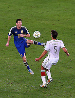 Lionel Messi of Argentina and Mats Hummels of Germany in action