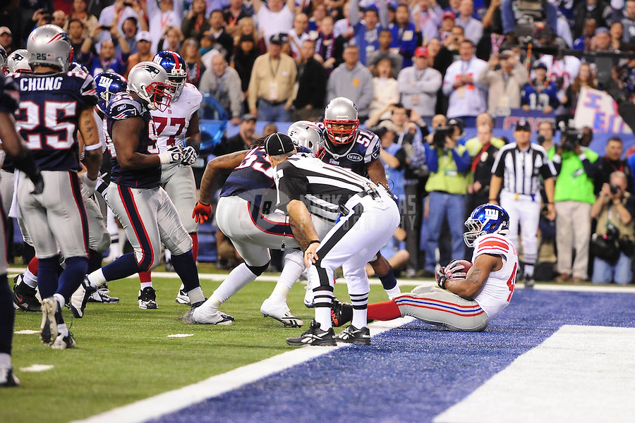 Feb 5, 2012; Indianapolis, IN, USA; New York Giants running back Ahmad Bradshaw (44) scores a touchdown against the New England Patriots during the second half of Super Bowl XLVI at Lucas Oil Stadium.  Mandatory Credit: Mark J. Rebilas-