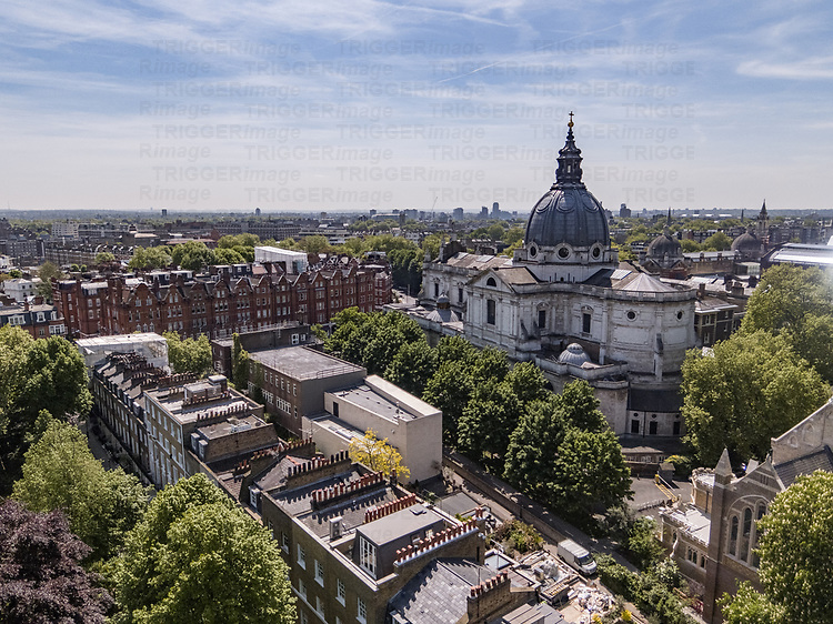 An aerial view above Kensington in London England UK with the London Oratory in the foreground with the Victoria & Albert museum with the river Thames in the background