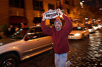 Daniel Loker, of Tower Grove East, runs down second street in Laclede's Landing waving a copy of the Post-Dispatch after the St. Louis Cardinals won the World Series against the Detroit Tigers on Friday, October 27, 2006.