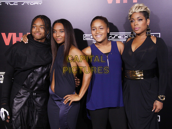 Tron Austin, Rozonda &quot;Chilli&quot; Thomas, Chase Anela Rolison, Tionne &quot;T-Boz&quot; Watkins<br /> At the Premiere of &quot;Crazy Sexy Cool The TLC Story&quot; at the AMC Loews Lincoln Square Theatre, New York City, NY., USA.<br /> October 15th, 2013<br /> half length black dress sleeveless cut out away belly stomach midriff blue top leather gold belt <br /> CAP/MPI/RW<br /> &copy;RW/ MediaPunch/Capital Pictures