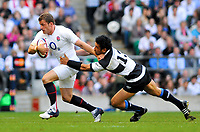 Mark Cueto tries to evade the challenge of Casey Laulala. MasterCard Trophy International match between England and the Barbarians on May 30, 2010 at Twickenham Stadium in London, England. [Mandatory Credit: Patrick Khachfe/Onside Images]
