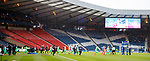 The teams walk out to an empty Hibs end