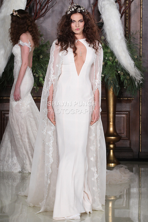"""Model walks runway in a Jewel wedding gown from the Galia Lahav Haute Couture """"Les Reves Bohemiens"""" collection, during New York Bridal Fashion Week Spring 2016."""