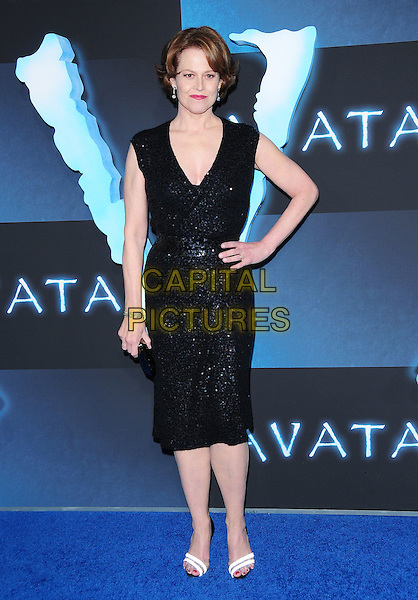 SIGOURNEY WEAVER.The Twentieth Century Fox World Premiere of Avatar held at The Grauman's Chinese Theatre in Hollywood, California, USA. .December 16th, 2009.full length black dress sequined sequins wrap low cut white open toe shoes sandals clutch bag hand on hip.CAP/RKE/DVS.©DVS/RockinExposures/Capital Pictures.