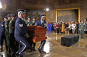 Washington, D.C. - October 30, 2005 -- A military honor guard carries the casket of civil rights icon Rosa Parks into the United States Capitol Rotunda in Washington, D.C. where her remains will lie in honor on October 30, 2005..Credit: Martin H. Simon - Pool via CNP