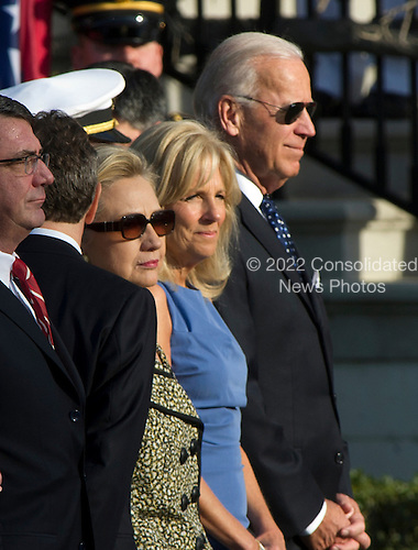 United States Vice President Joe Biden, Dr. Jill Biden and U.S. Secretary of State Hillary Rodham Clinton await the arrival of United States President Barack Obama and first lady Michelle Obama as they prepare to welcome Prime Minister David Cameron of Great Britain and his wife, Samantha, to the White House in Washington, D.C. on Wednesday, March 14, 2012..Credit: Ron Sachs / CNP