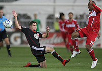 Devon McTavish of D.C. United tries to stop a cross from Collins John #15 of the Chicago Fire during an MLS match on April 17 2010, at RFK Stadium in Washington D.C.