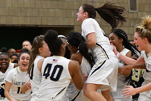 Jenna Annecchiarico #13 of Baldwin, top, and teammates celebrate after their 56-31 win over Central Islip in the Class AA varsity girls basketball Long Island Championship at SUNY Old Westbury on Saturday, March 11, 2017.
