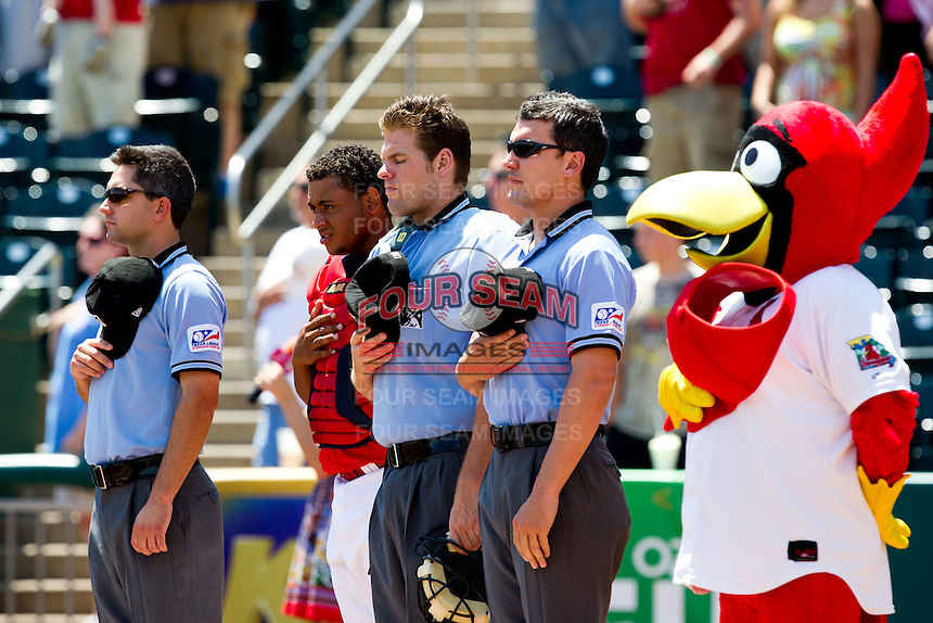 First Base Umpire Greg Stanzak (left), Home Plate Umpire Brandon Misun (center), and Third Base Umpire Jimmy Volpi (right) stand with Audry Perez (10) of the Springfield Cardinals and the Cardinals mascot Louie during the national anthem prior to a game between the San Antonio Missions and the Springfield Cardinals on May 30, 2011 at Hammons Field in Springfield, Missouri.  Photo By David Welker/Four Seam Images