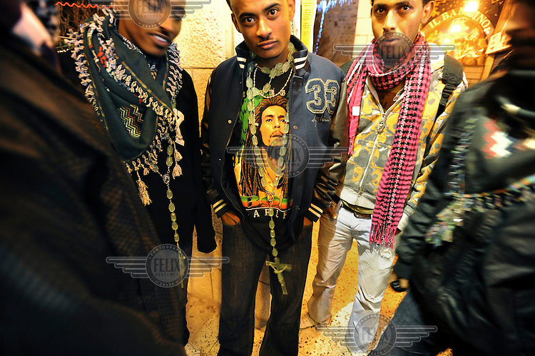 Eritrean asylum seeker youth, who reside in Tel Aviv, hang out at Mangar Square, as their community celebrates the Coptic Christmas in Bethlehem, West Bank...