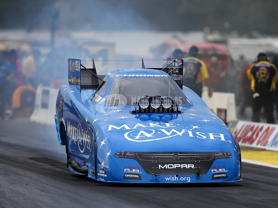 Aug 18, 2017; Brainerd, MN, USA; NHRA funny car driver Tommy Johnson Jr during qualifying for the Lucas Oil Nationals at Brainerd International Raceway. Mandatory Credit: Mark J. Rebilas-USA TODAY Sports