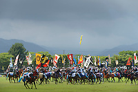 Horseback riders compete to catch flags falling from the air. Somanomaoi Festival, Minami-soma City, Fukushima Prefecture, Japan, July 28, 2013. During the four-day-long Somanomaoi Festival members of old samurai families ride horseback through the town in traditional armour.  They also take conduct ceremonies at local shrines, take part in horse races, and compete on horseback to catch a flag launched into the air by fireworks.