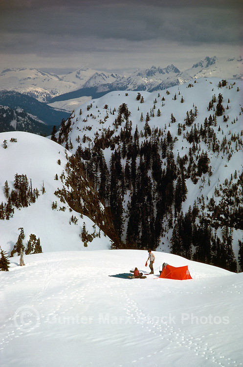 Couple camping with Tent in Snow in Mount Seymour Provincial Park, in the Coast Mountains, North Vancouver, Southwestern British Columbia, Canada, in Winter / Spring