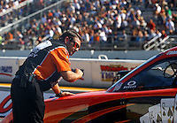 Aug. 17, 2013; Brainerd, MN, USA: Crew chief Rob Wendland for NHRA funny car driver Johnny Gray during qualifying for the Lucas Oil Nationals at Brainerd International Raceway. Mandatory Credit: Mark J. Rebilas-