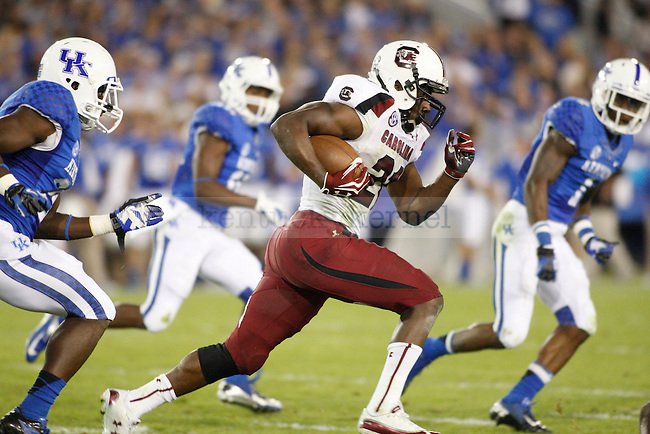 South Carolina Gamecocks running back Marcus Lattimore (21) runs with the ball during the second half of the University of Kentucky football vs.  South Carolina at Commonwealth Stadium in Lexington, Ky., on Saturday, September 29, 2012. Photo by Tessa Lighty | Staff