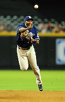 Aug. 30, 2010; Phoenix, AZ, USA; San Diego Padres shortstop Miguel Tejada throws to first base after forcing out Arizona Diamondbacks base runner Justin Upton (not pictured) in the first inning at Chase Field. Mandatory Credit: Mark J. Rebilas-