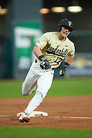 Walker Grisanti (17) of the Vanderbilt Commodores rounds third base against the Houston Cougars during game nine of the 2018 Shriners Hospitals for Children College Classic at Minute Maid Park on March 3, 2018 in Houston, Texas. The Commodores defeated the Cougars 9-4. (Brian Westerholt/Four Seam Images)