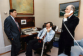 United States President George H.W. Bush speaks with US Secretary of State James A. Baker, III, from his study in the Oval Office of the White House in Washington, DC on January 17, 1991.  Pictured from left to right: White House Chief of Staff John Sununu, the President, and National Security Advisor Brent Scowcroft.<br /> Mandatory Credit: David Valdez / White House via CNP