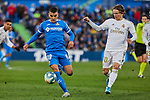 Mauro Arambarri of Getafe FC and Luka Modric of Real Madrid during La Liga match between Getafe CF and Real Madrid at Coliseum Alfonso Perez in Getafe, Spain. January 04, 2020. (ALTERPHOTOS/A. Perez Meca)